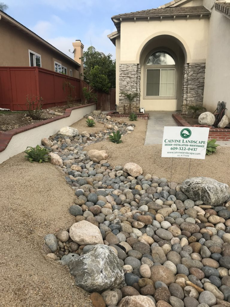Dry creek bed in front yard